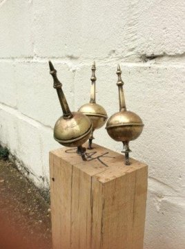 Brass finials drying after  cleaning and coating with protective lacquer