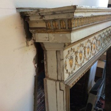 Period fireplace surround before restoration